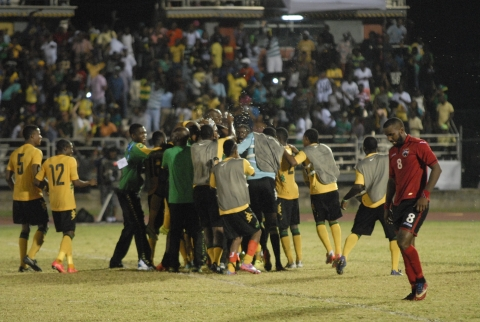 Jamaica's Reggae Boyz celebrate their penalty shoot-out victory over Trinidad & Tobago in the final of the 2014 Caribbean Cup tournament (Source: sportsmax.tv)